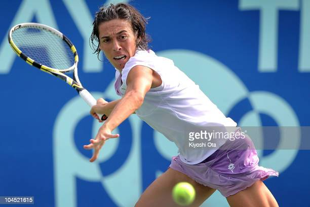 Francesca Schiavone of Italy plays a forehand in her match against Kimiko Date Krumm of Japan on day four of the Toray Pan Pacific Open tennis...
