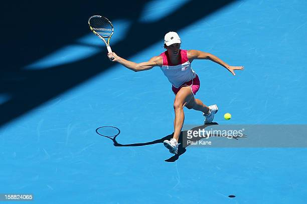 Francesca Schiavone of Italy plays a forehand in her singles match against Ana Ivanovic of Serbia during day three of the Hopman Cup at Perth Arena...