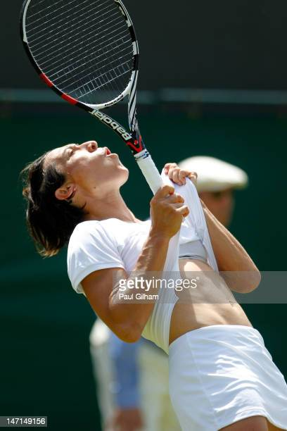 Francesca Schiavone of Italy reacts during her Ladies' Singles first round match against Laura Robson of Great Britain on day two of the Wimbledon...