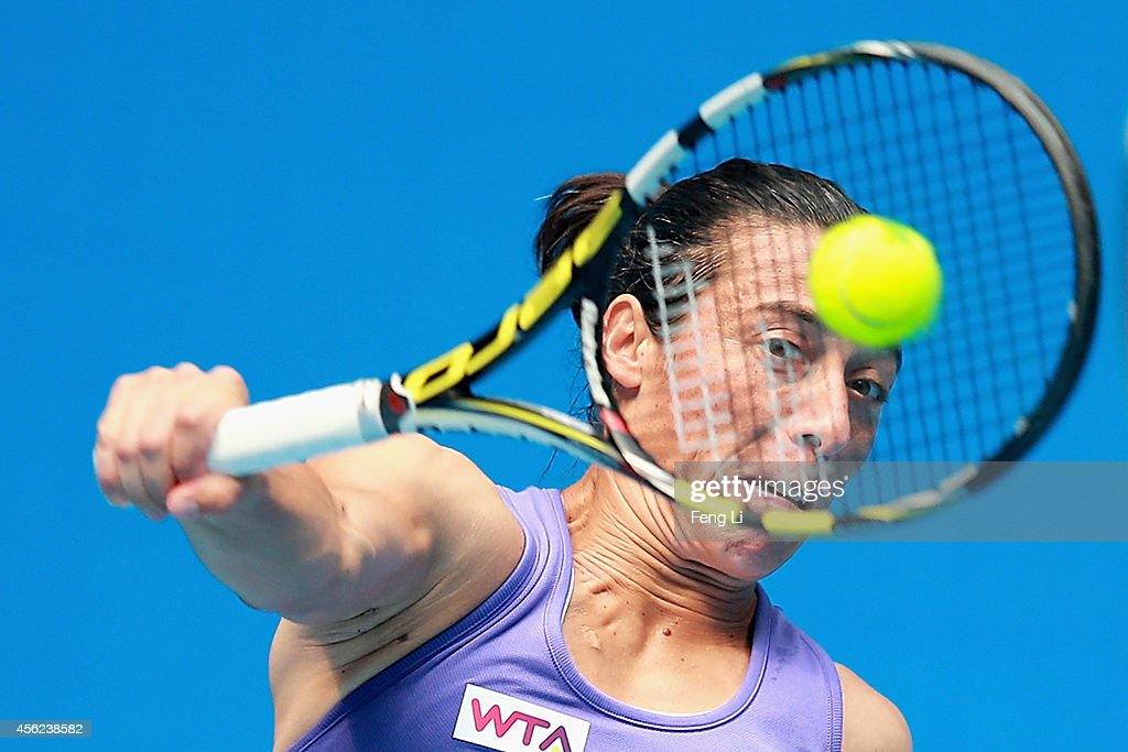 Francesca Schiavone of Italy returns a shot against Samantha Stosur of Australia during day two of the China Open at the China National Tennis Center on September 28, 2014 in Beijing, China.