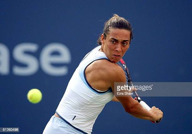 Francesca Schiavone of Italy returns to Angela Haynes during the US Open September 3, 2004 at the USTA National Tennis Center in Flushing Meadows...