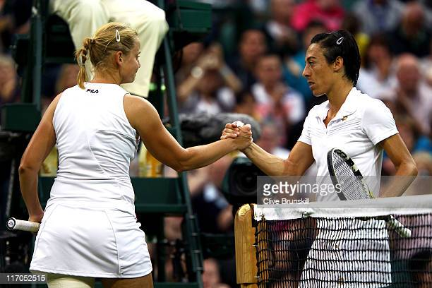 Francesca Schiavone of Italy shakes hands with Jelena Dokic of Australia after winning first round match on Day One of the Wimbledon Lawn Tennis...