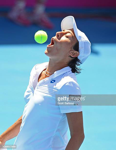 Francesca Schiavone of Italy spits a tennis ball out of her mouth during her match against Samantha Stosur of Australia during day two of the...