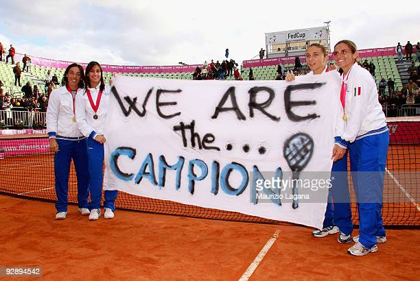 Francesca SchiavoneFlavia Pennetta Sara Errani and Roberta Vinci of Italy show a champions banner during the awards ceremony after the final of the...