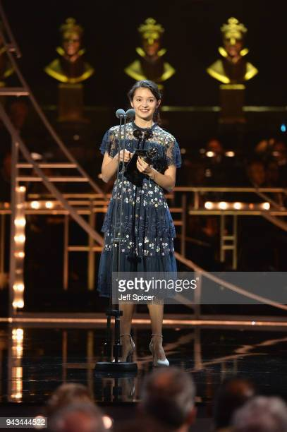 Francesca Velicu receives with the award for Outstanding Achievement In Dance on stage during The Olivier Awards with Mastercard at Royal Albert Hall...