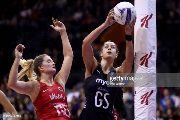 Francesca Williams of England and Maia Wilson of New Zealand contest a pass during game 1 of the Cadbury Netball Series between the New Zealand...