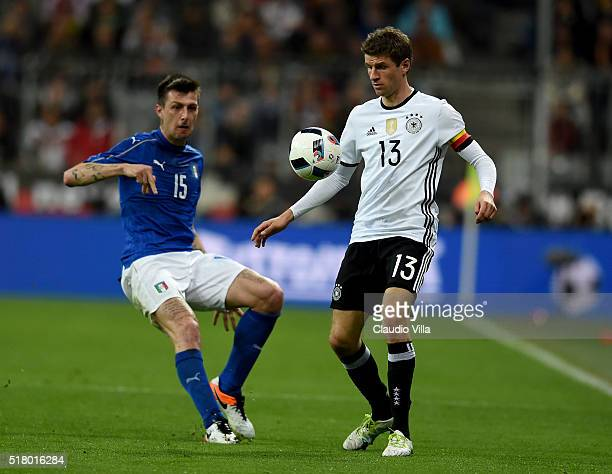 Francesco Acerbi of Italy and Thomas Muller of Germany compete for the ball during the international friendly match between Germany and Italy at...
