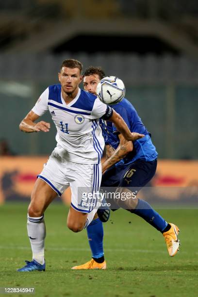 Francesco Acerbi of Italy competes for the ball with Edin Dzeko of Bosnia and Herzegovina during the UEFA Nations League group stage match between...