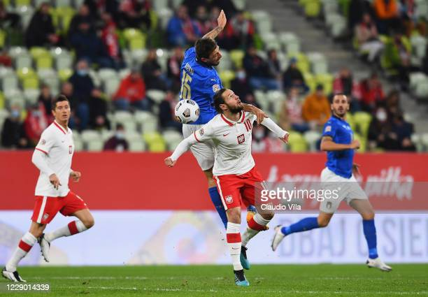 Francesco Acerbi of Italy competes for the ball with Grzegorz Krychowiak of Poland during the UEFA Nations League group stage match between Poland...