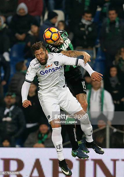 Francesco Acerbi of Sassuolo competes for the ball with Levan Mchedlidze of Empoli during the Serie A match between US Sassuolo and Empoli FC at...