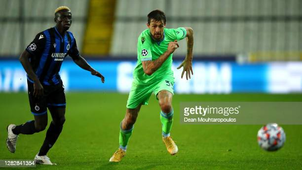 Francesco Acerbi of SS Lazio battles for the ball with Krepin Diatta of Club Brugge KV during the UEFA Champions League Group F stage match between...