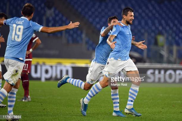 Francesco Acerbi of SS Lazio celebrates the opening goal with his team mates during the Serie A match between SS Lazio and Torino FC at Stadio...