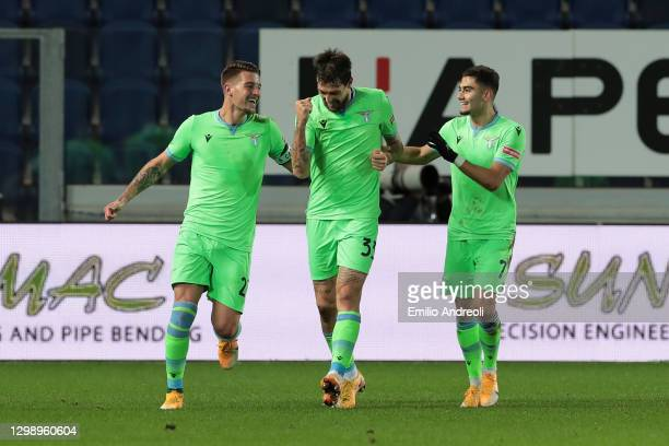 Francesco Acerbi of SS Lazio celebrates with team mates Sergej Milinkovic-Savic and Andreas Pereira after scoring their side's second goal during the...