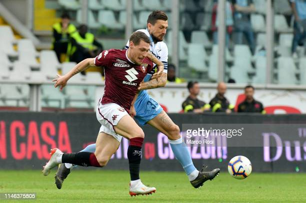 Francesco Acerbi of SS Lazio compete for the ball with Andrea Belotti of Torino FC during the Serie A match between Torino FC and SS Lazio at Stadio...