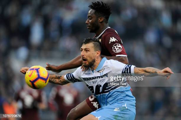 Francesco Acerbi of SS Lazio compete for the ball with Koffi Djidji of Torino FC during the Serie A match between SS Lazio and Torino FC at Stadio...