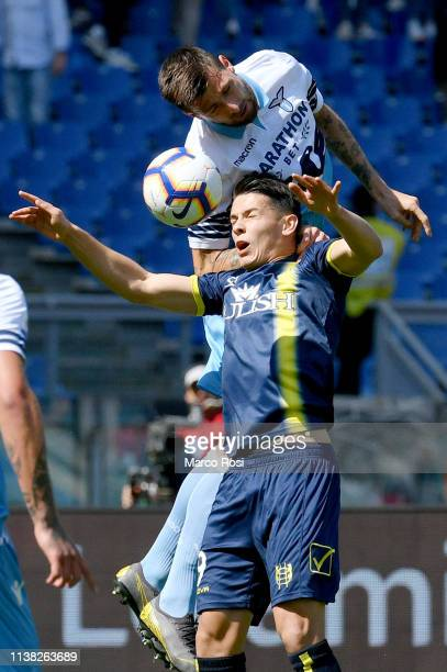 Francesco Acerbi of SS Lazio compete for the ball with Mariusz Stephinsky during the Serie A match between SS Lazio and Chievo at Stadio Olimpico on...
