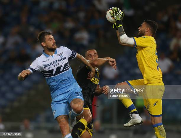 Francesco Acerbi of SS Lazio competes for the ball with Cristian Molinaro and Marco Sportiello of Frosinone Calcio in action during the serie A match...