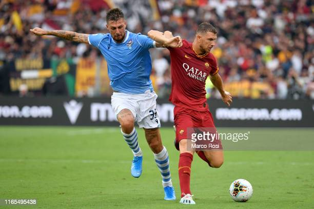 Francesco Acerbi of SS Lazio competes for the ball with Edin Dzeko of AS Roma during the Serie A match between SS Lazio and AS Roma at Stadio...