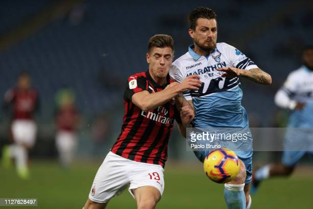 Francesco Acerbi of SS Lazio competes for the ball with Krzysztof Piatek of AC Milan during the Coppa Italia match between SS Lazio and AC Milan on...