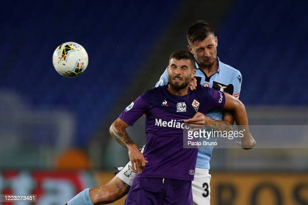 Francesco Acerbi of SS Lazio competes for the ball with Patrick Cutrone of ACF Fiorentina during the Serie A match between SS Lazio and ACF...
