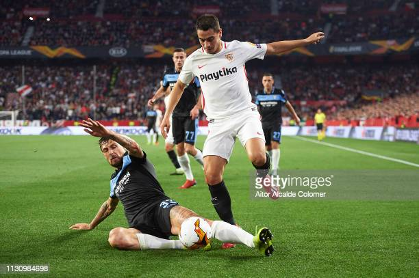 Francesco Acerbi of SS Lazio competes for the ball with Wissam Ben Yedder of Sevilla FC during the UEFA Europa League Round of 32 Second Leg match...