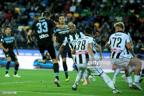 Francesco Acerbi of SS Lazio scores the opening goal during the serie A match between Udinese and SS Lazio at Stadio Friuli on September 26 2018 in...