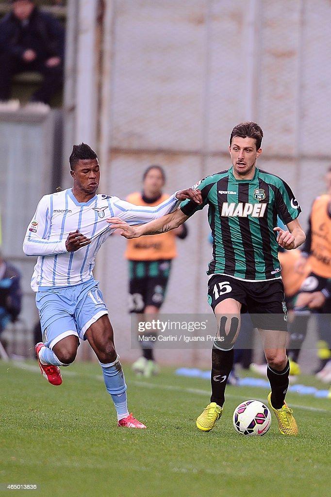 Francesco Acerbi # 15 of US Sassuolo Calcio ( R ) competes the ball with Balde Keita # 14 of SS Lazio ( L ) during the Serie A match between US Sassuolo Calcio and SS Lazio on March 1, 2015 in Reggio nell'Emilia, Italy.