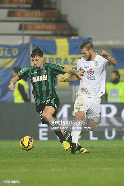 Francesco Acerbi of US Sassuolo Calcio competes the ball with Panagiotis Tachtsidis of Hellas Verona FC during the Serie A match between US Sassuolo...