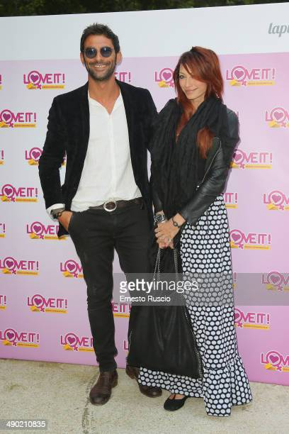 Francesco Arca and Irene Capuano attend the 'Love It' Campaign For Safe Sex party at Villa Laetitia on May 13 2014 in Rome Italy