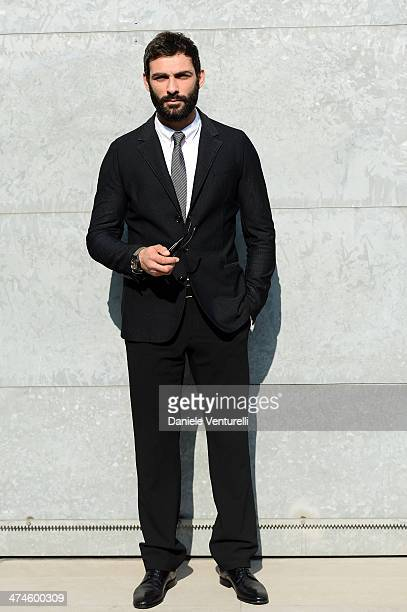 Francesco Arca attends the Giorgio Armani show during the Milan Fashion Week Womenswear Autumn/Winter 2014 on February 24 2014 in Milan Italy