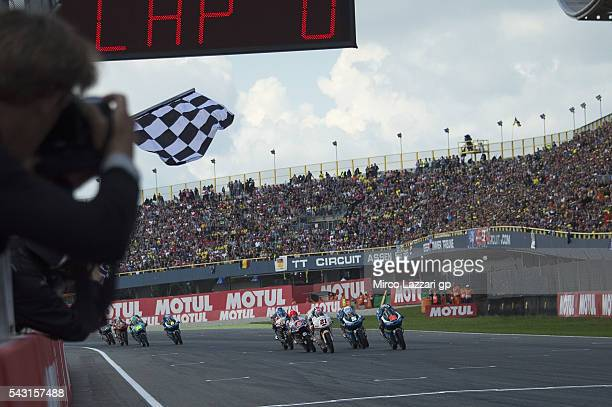 Francesco Bagnaia of Italy and Aspar Team Moto3 cuts the finish lane at the end of the Moto3 race during the MotoGP Netherlands Race at on June 26...