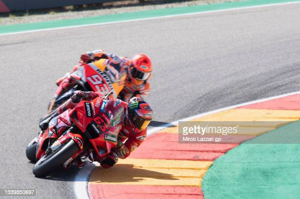 Francesco Bagnaia of Italy and Ducati Lenovo Team leads Marc Marquez of Spain and Repsol Honda Team during the MotoGP race during the MotoGP of...