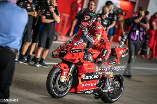 Francesco Bagnaia of Italy and Ducati Lenovo Team rolls into parc ferme after his first MotoGP pole position during qualifying session at Losail...