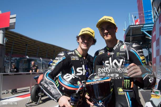 Francesco Bagnaia of Italy and Sky Racing Team VR46 and Luca Marini of Italy and Sky Racing Team VR46 celebrate at the end of the Moto2 Qualifying...
