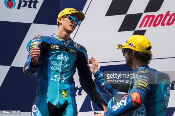 Francesco Bagnaia of Italy and Sky Racing Team VR46 celebrates with Luca Marini of Italy and Sky Racing Team VR46 on the podium at the end of the...