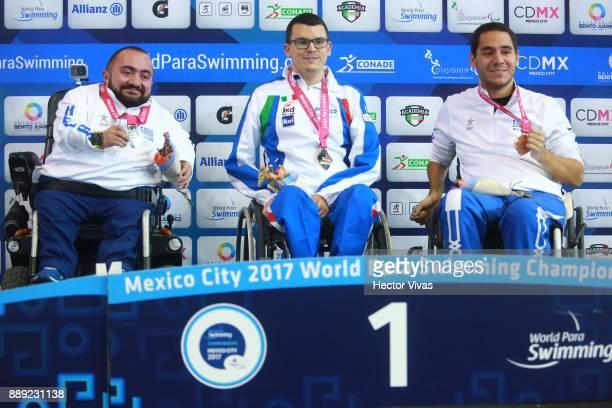 Francesco Betella of Italy Gold Medal Dimitrios Karypidis Silver Medal and Apostolos Tsaousis Bronze Medal pose after the men's 100 m Backstroke S1...