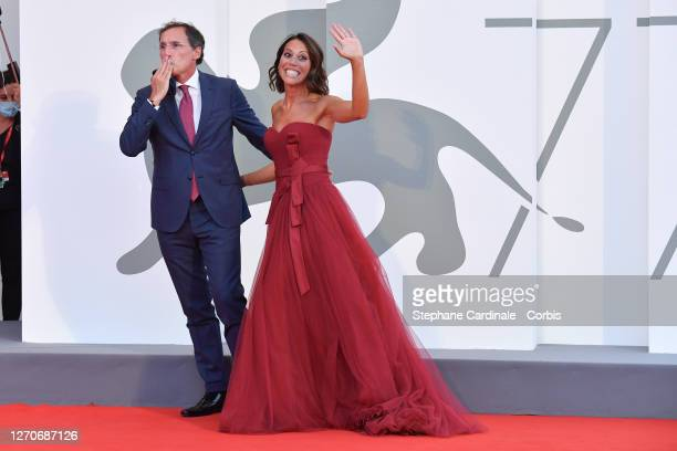 "Francesco Boccia and Nunzia De Girolamo walk the red carpet ahead of the movie ""Padrenostro"" at the 77th Venice Film Festival at on September 04,..."