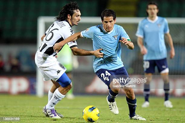 Francesco Bolzoni of AC Siena fights for the ball with Cristian Daniel Ledesma of SS Lazio during the Serie A match between AC Siena and SS Lazio at...