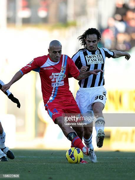 Francesco Bolzoni of AC Siena fights for the ball with Sergio Bernardo Almiron of Calcio Catania during the Serie A match between AC Siena and Calcio...