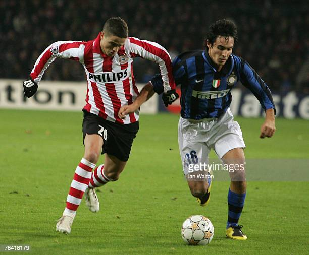 Francesco Bolzoni of Inter Milan tries to tackle Ibrahim Afellay of PSV Einhoven during the UEFA Champions League Group G match between PSV Einhoven...