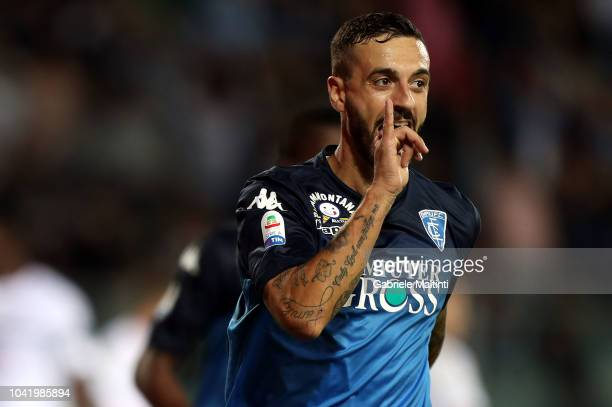 Francesco Caputo of Empoli FC celebrates after scoring the opening goal during the serie A match between Empoli and AC Milan at Stadio Carlo...