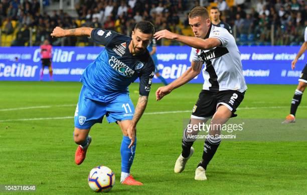 Francesco Caputo of Empoli Fc competes for the ball with Simone Iacoponi of Parma Calcio during the Serie A match between Parma Calcio and Empoli at...