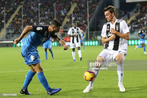 Francesco Caputo of Empoli FC in action against Daniele Rugani of Juventus during the Serie A match between Empoli and Juventus at Stadio Carlo...