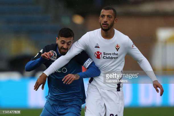 Francesco Caputo of Empoli FC in action against Vitor Hugo of ACF Fiorentina during the Serie A match between Empoli and ACF Fiorentina at Stadio...