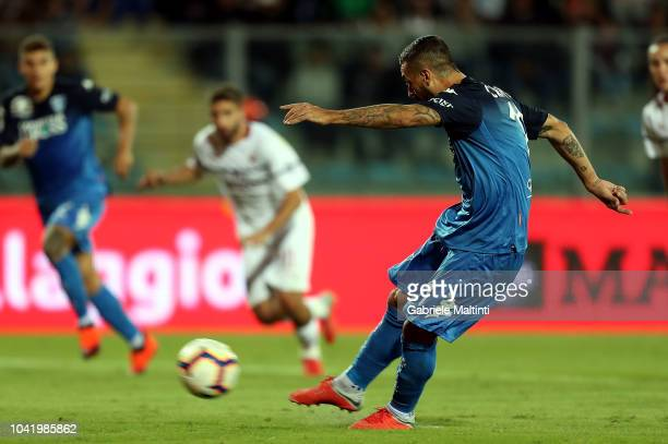 Francesco Caputo of Empoli FC scores the opening goal during the serie A match between Empoli and AC Milan at Stadio Carlo Castellani on September 27...