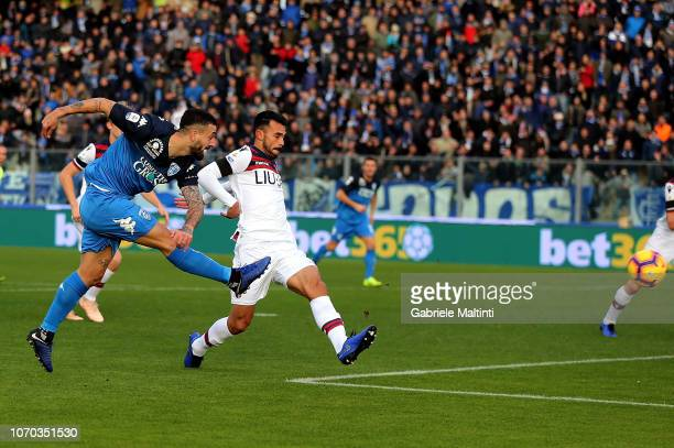 Francesco Caputo of Empoli FC scores the opening goal during the Serie A match between Empoli and Bologna FC at Stadio Carlo Castellani on December 9...