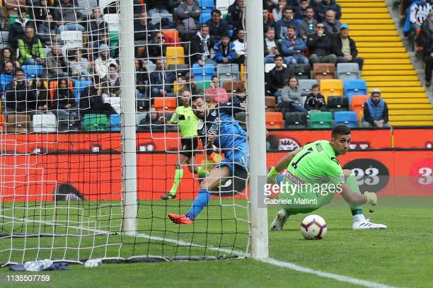 Francesco Caputo of Empoli FC scores the opening goal during the Serie A match between Udinese and Empoli at Stadio Friuli on April 7, 2019 in Udine,...