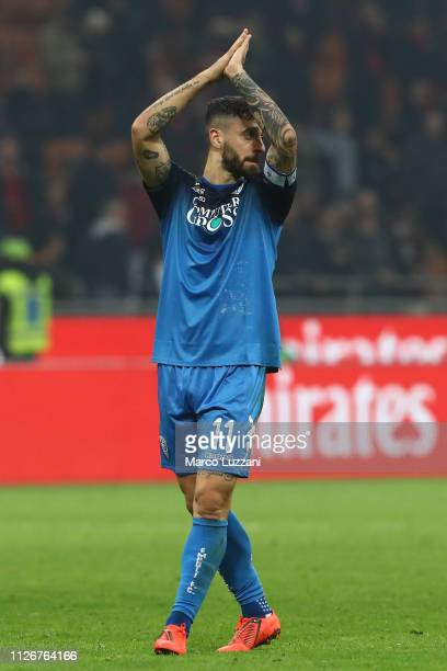 Francesco Caputo of Empoli salutes the fans at the end of at the Serie A match between AC Milan and Empoli at Stadio Giuseppe Meazza on February 22...