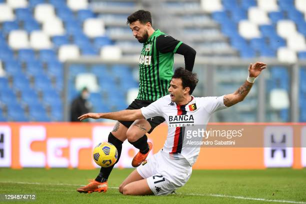 Francesco Caputo of Sassuolo battles for possession with Lasse Schoene of Genoa during the Serie A match between US Sassuolo and Genoa CFC at Mapei...