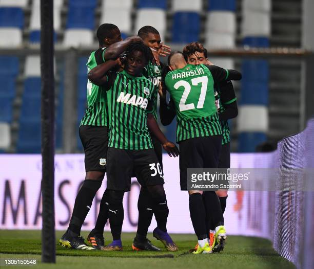 Francesco Caputo of Sassuolo celebrates with teammates after scoring their team's third goal from the penalty spot during the Serie A match between...